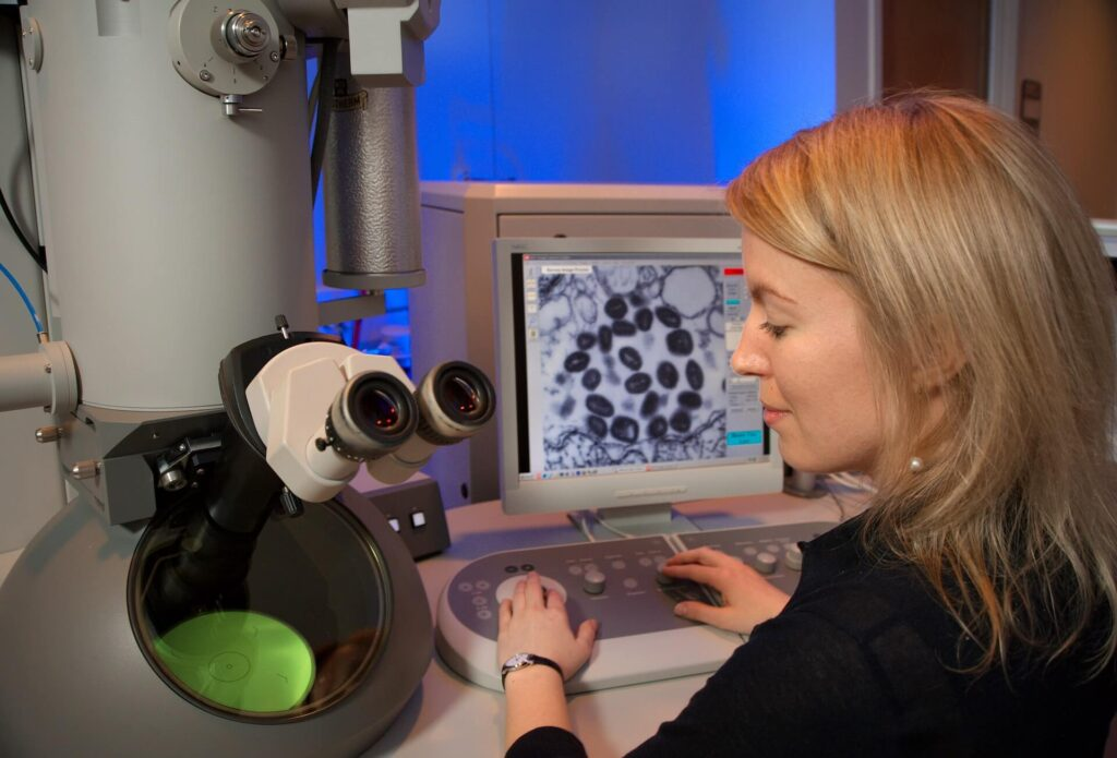A young girl testing the virus in the lab. The microscope's screen was displaying a thin section of the variola virus