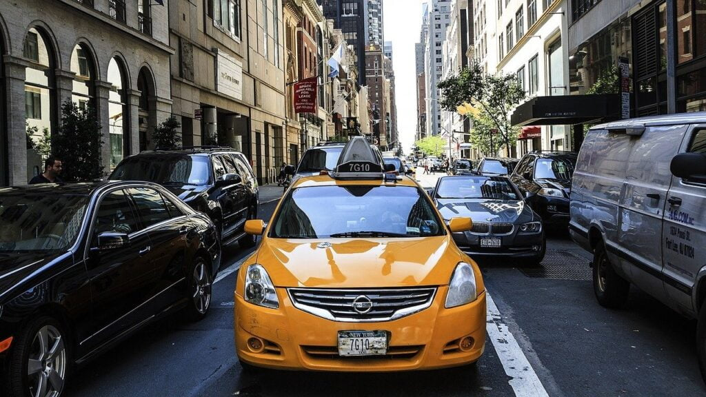 A yellow taxi in traffic