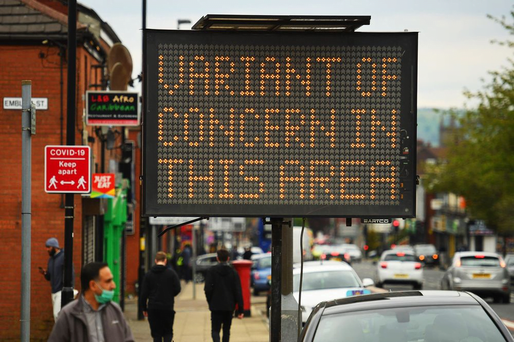 The electronic display on the street warns that there are cases of COVID-19 infection in this area. /AFP